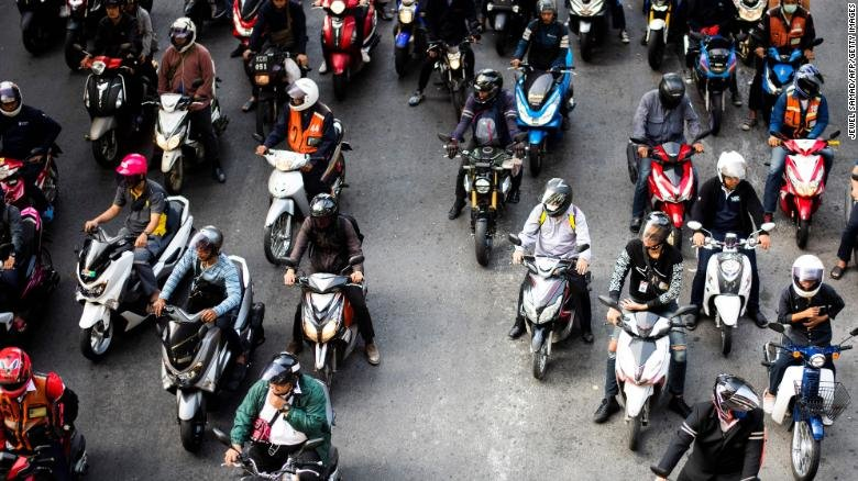 Motorists wait at a traffic light in Bangkok on November 29, 2018.